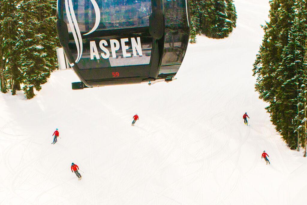 skiers aspen mountain
